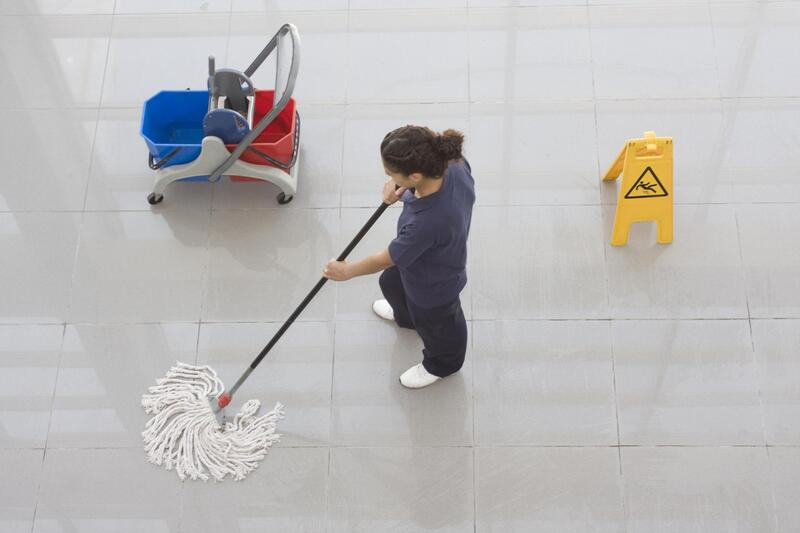 cleaner doing company floor cleaning
